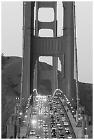 Traffic on Golden Gate Bridge at sunset. San Francisco, California, USA (black and white)