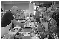Choosing cheese at the Cheese Board. Berkeley, California, USA (black and white)
