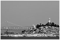 Telegraph Hill and Bay Bridge at dusk. San Francisco, California, USA ( black and white)