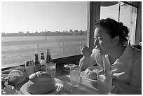 Woman eating clam chowder in a sourdough bread bowl. Santa Cruz, California, USA ( black and white)