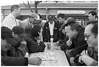 Vietnamese immigrants at a Chinese chess game. San Jose, California, USA ( black and white)