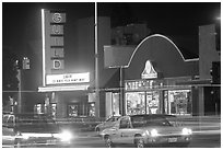 El Camino Real at night, with movie theater and Menlo Clock Works. Menlo Park,  California, USA (black and white)