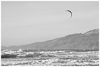 Kite surfer in Pacific Ocean waves, afternoon. San Francisco, California, USA (black and white)