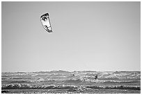 Kitesurfer in powerful waves, afternoon. San Francisco, California, USA (black and white)