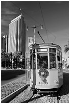 Historic trolley car and Embarcadero center building. San Francisco, California, USA (black and white)