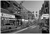 Lanterns and lights on Grant Street at dusk, Chinatown. San Francisco, California, USA (black and white)
