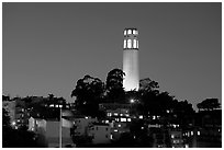 Coit Tower and Telegraph Hill at night. San Francisco, California, USA (black and white)