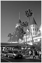 Entrance of hotel del Coronado, with cars and tourists walking. San Diego, California, USA ( black and white)