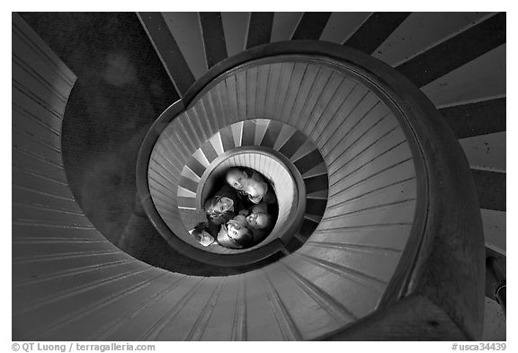 Children standing at the bottom of stairwell, Point Loma Lighthous. San Diego, California, USA (black and white)