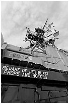Island and flags,  USS Midway aircraft carrier. San Diego, California, USA (black and white)