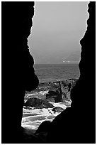 View through a seacave at the Cove. La Jolla, San Diego, California, USA ( black and white)