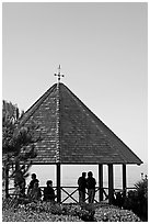 People standing in a Heisler Park Gazebo. Laguna Beach, Orange County, California, USA (black and white)