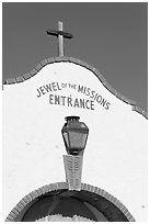Entrance with sign Jewel of the Missions. San Juan Capistrano, Orange County, California, USA (black and white)