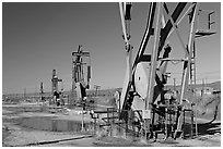 Oil extracting machinery, Chevron field. California, USA (black and white)