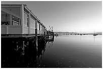 Waterfront restaurant in Morro Bay harbor, sunset. Morro Bay, USA ( black and white)