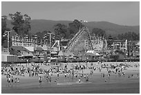 Beach and boardwalk in summer, afternoon. Santa Cruz, California, USA ( black and white)
