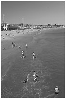 Children playing on the beach. Santa Cruz, California, USA (black and white)