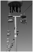 Riding the beach boardwalk aerial gondola. Santa Cruz, California, USA ( black and white)