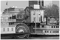 Riverboats Delta King and Spirit of Sacramento, modern and old buildings. Sacramento, California, USA ( black and white)