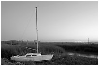 Yacht and marsh at dusk, Alviso. San Jose, California, USA (black and white)
