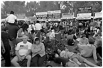 Crowd sitting on the grass in Guadalupe River Park, Independence Day. San Jose, California, USA ( black and white)