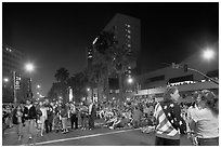 Families waiting for fireworks on Almaden street, Independence Day. San Jose, California, USA (black and white)