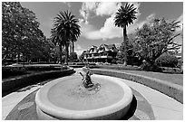 Wide view of fountain, gardens,  and mansion. Winchester Mystery House, San Jose, California, USA (black and white)