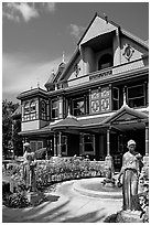 Statues, fountain, and facade. Winchester Mystery House, San Jose, California, USA (black and white)