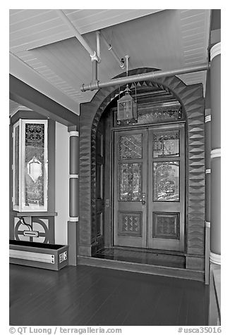 Main entrance doors, always locked. Winchester Mystery House, San Jose, California, USA (black and white)