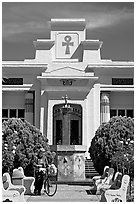 Person walking a bike, Rosicrucian Park. San Jose, California, USA (black and white)