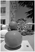 Sculpture  and outdoor restaurant terrace, Castro Street, Mountain View. California, USA ( black and white)