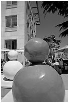 Sculptures and outdoor lunch, Castro Street, Mountain View. California, USA ( black and white)