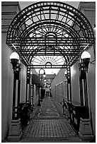 Alley and gate leading to Castro Street, Mountain View. California, USA ( black and white)