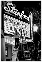 Woman changing movie title, Stanford Theatre. Palo Alto,  California, USA (black and white)