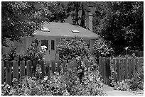 House with flowers in front yard. Menlo Park,  California, USA (black and white)