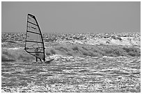 Windsurfer on silvery ocean, Waddell Creek Beach. California, USA (black and white)