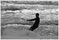 Kitesurfer silhouette against silvery water, Waddell Creek Beach. California, USA (black and white)