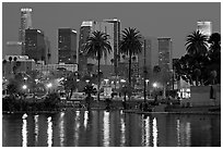 Skyline and lights reflected in a lake in Mc Arthur Park. Los Angeles, California, USA (black and white)