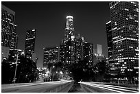 Traffic lights and skyline at night. Los Angeles, California, USA (black and white)