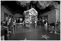 Walk of fame and entrance of El Capitan Theater. Hollywood, Los Angeles, California, USA (black and white)