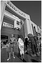 People dressed as movie characters in front of the Kodak Theatre. Hollywood, Los Angeles, California, USA (black and white)