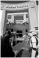 People dressed as Star Wars characters in front of the Kodak Theater, home of the Academy Awards. Hollywood, Los Angeles, California, USA ( black and white)
