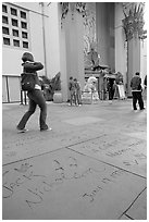 Footprints and handprints of Jack Nicholson in the Grauman theatre forecourt. Hollywood, Los Angeles, California, USA ( black and white)