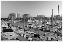 Yachts and appartment buildings at sunrise. Marina Del Rey, Los Angeles, California, USA (black and white)