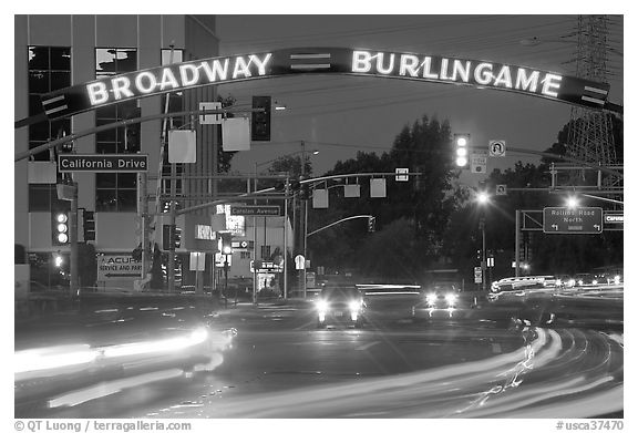 Broadway at night with lights from moving cars. Burlingame,  California, USA