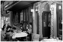 Outdoor table of Italian restaurant at night. Burlingame,  California, USA (black and white)
