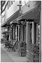 Storefront and public benches on Main Street. Half Moon Bay, California, USA (black and white)
