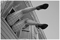 Giant lady legs on Haight street, Haight-Ashbury District. San Francisco, California, USA (black and white)