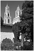 Bell towers of the Basilica seen from the Garden, Mission San Francisco de Asis. San Francisco, California, USA (black and white)