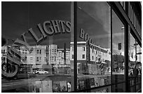 City Light Bookstore window glass and city reflections, North Beach. San Francisco, California, USA (black and white)